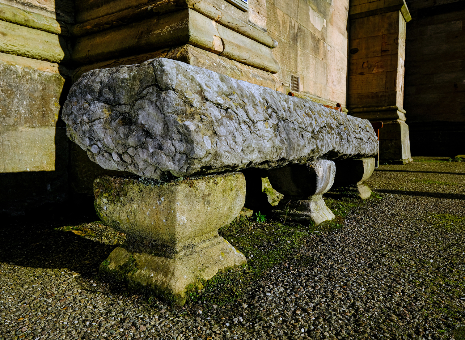 Length of stone 2m and 30cm wide sitting on three stone plinths to make a bench