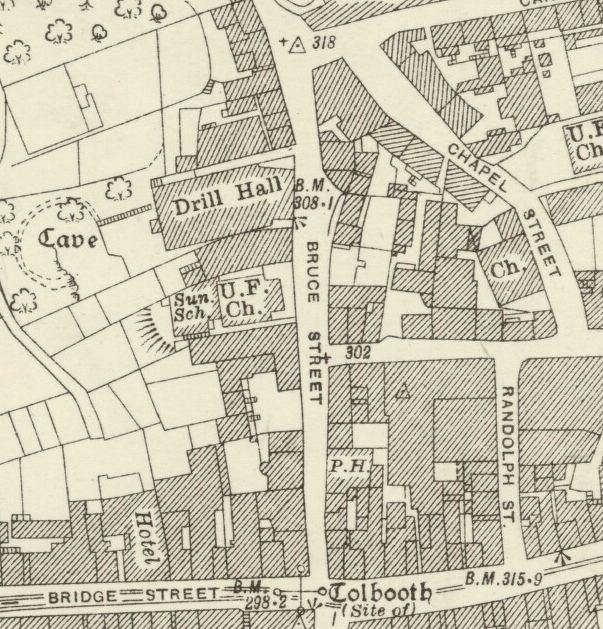 1926 Ordnance Survey Town Map showing Bruce Street and surrounding streets in Dunfermline. Location 5 properties up from Bridge Street on east(right) side of Bruce Street is marked 'P.H.' indicating a public house.
