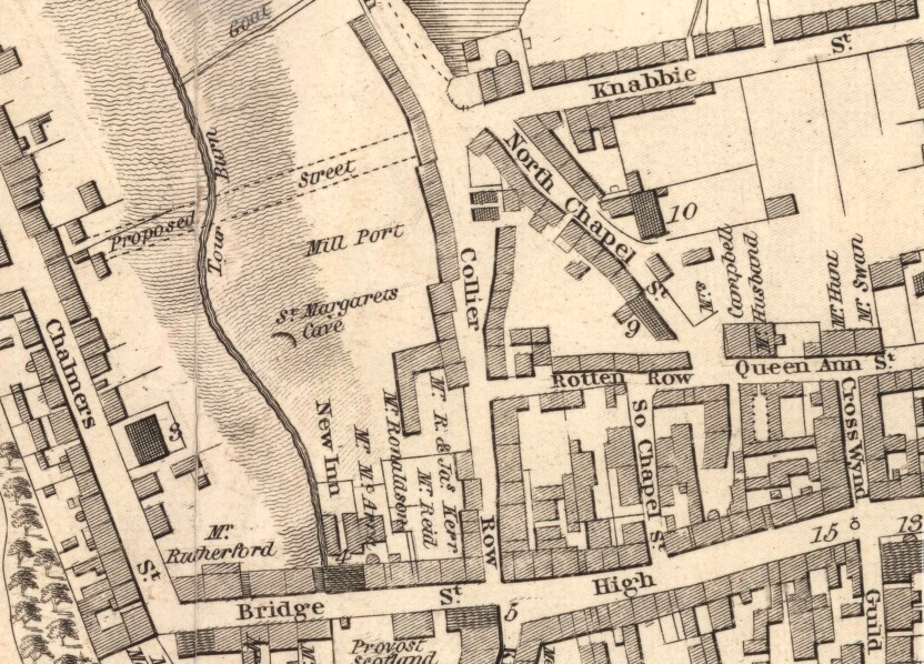 Map from 1823 showing Collier Row coming from the top of the screen to bottom and joining with Bridge Street and High Street. Other details include Mill Port and St Margarets Cave in land on left of Row with no buildings. On the right of Collier Row is Knabbie street, North Chapel, Rotten Row and Queen Ann Street.